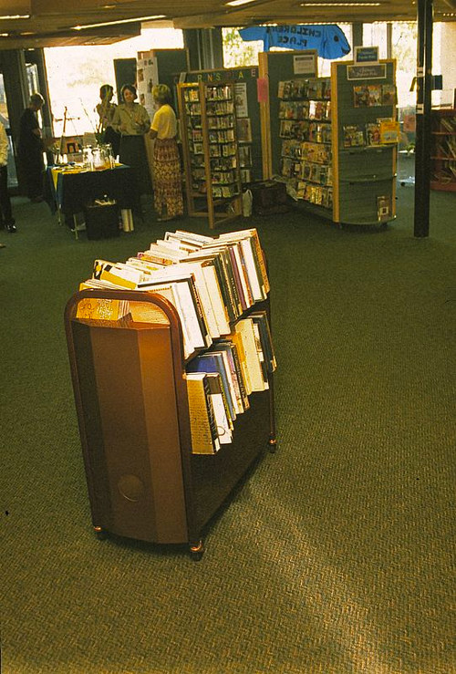 A photo of an installation using a cart of books