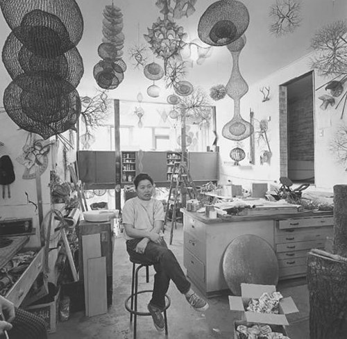 A photo of Ruth Asawa in her studio
