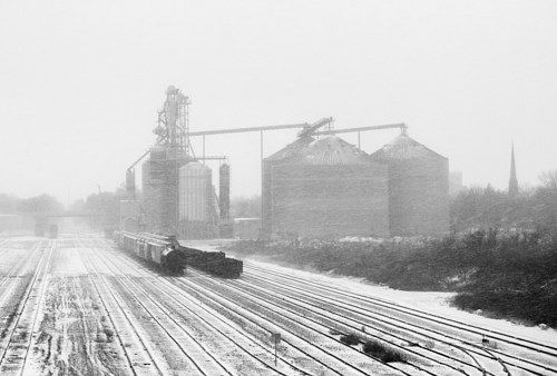 A photo of train tracks in a snowstorm in illinois