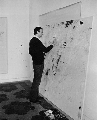 "The artist Cy Twombly at work in his studio."" width="