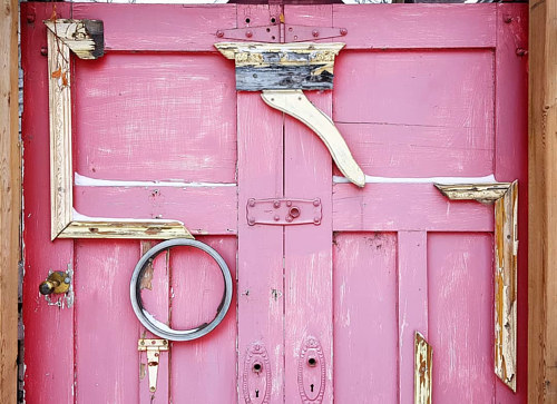 A photograph of a pink doorway
