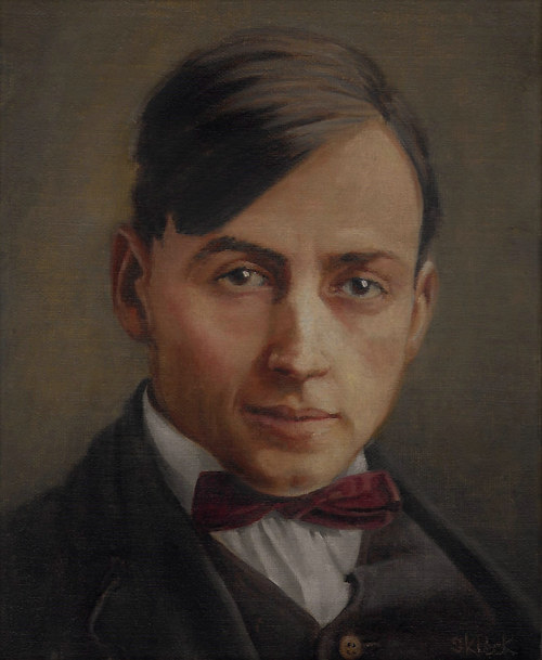 A portrait of a young man in 20th century dress