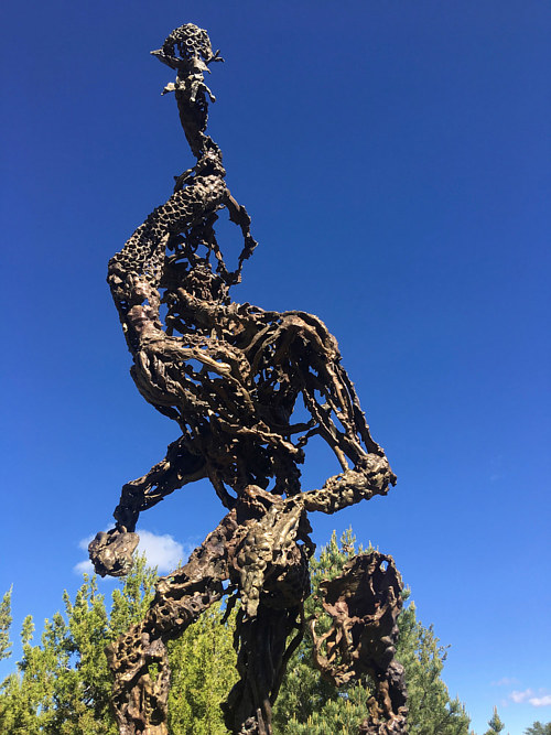An outdoor sculpture of an abstracted figure