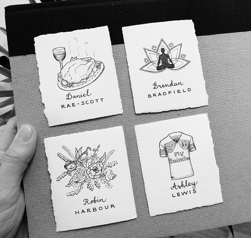 A set of handmade name cards with unique illustrations