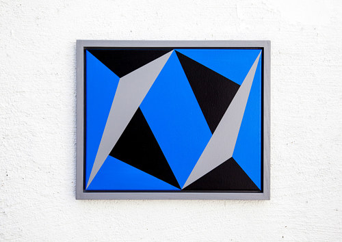 A geometric painting with planes of blue and black