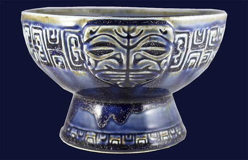 A tiki-style bowl with custom design and ultramarine blue glaze
