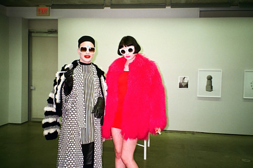 A photo of a pair dressed in bright colours in a gallery space