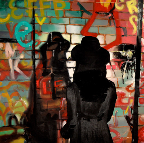 A painting of a woman looking at colourful graffitti