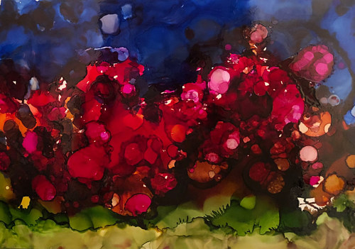 An alcohol ink painting with bright red hues