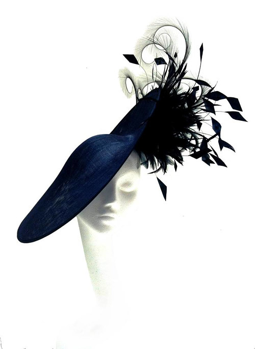 A handmade hat with black feathers