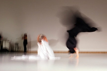 A photo of two dancers in motion
