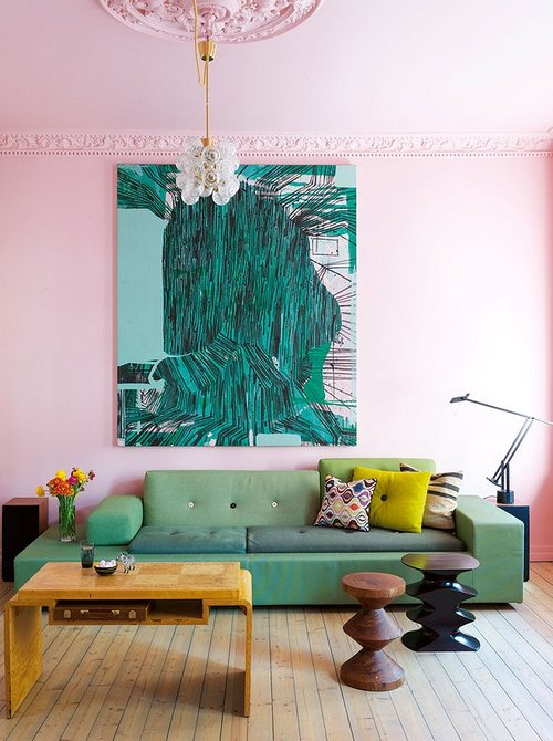 large artwork hanging above a couch