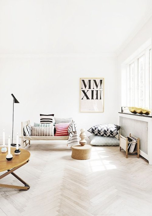 white room with small artwork above couch