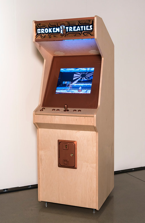 An art piece consisting of an arcade console and an original video