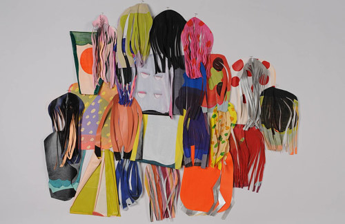 An artwork consisting of a series of cut fabric pieces