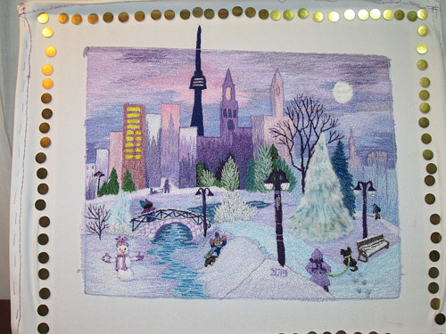 An embroidered artwork of a cityscape with a purple sky