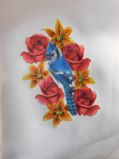 A drawing of a blue jay in a bunch of flowers