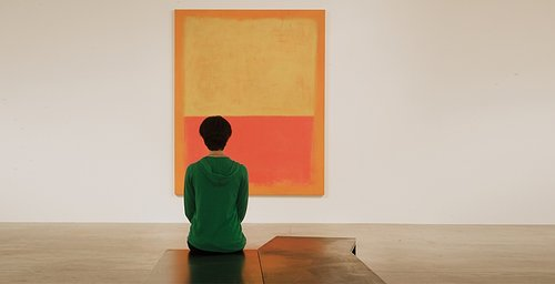 a woman looking at a minimalist artwork