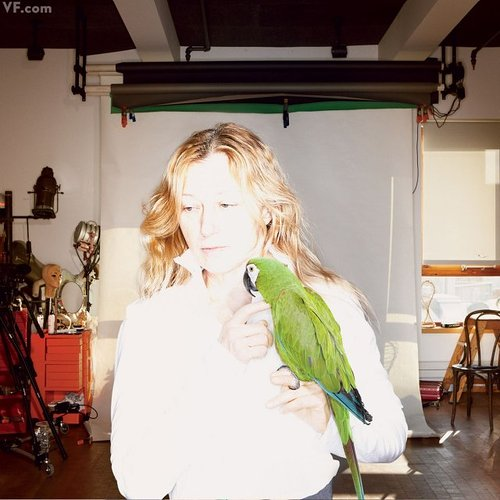 Cindy Sherman holding a parrot