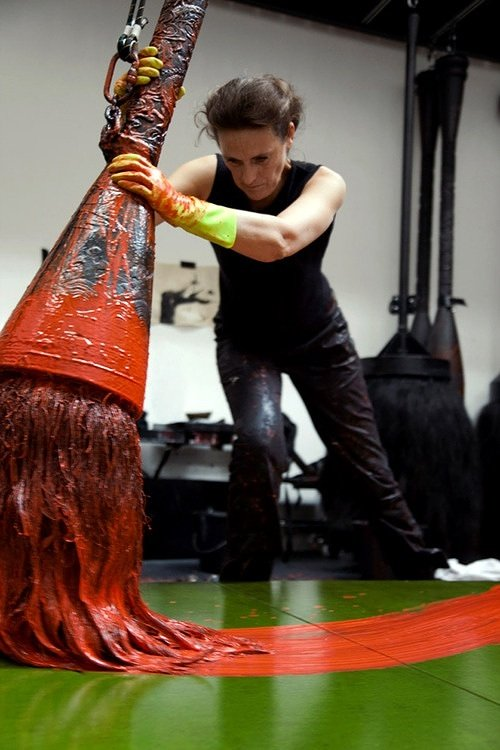 artist using a giant brush