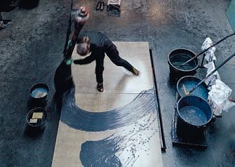aerial image of woman using a giant paint brush