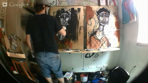 artist working on two paintings