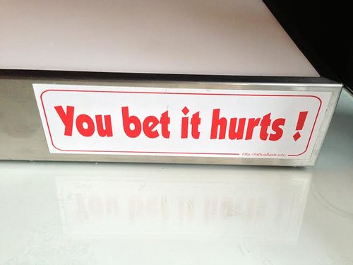 sign that says you bet it hurts