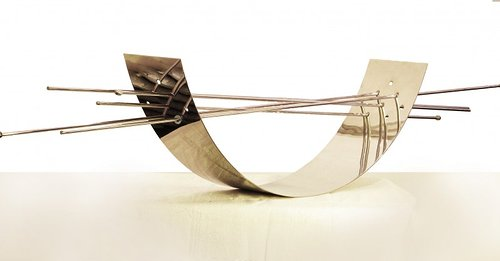 stainless steel sculpture in arc shape with metal tubes