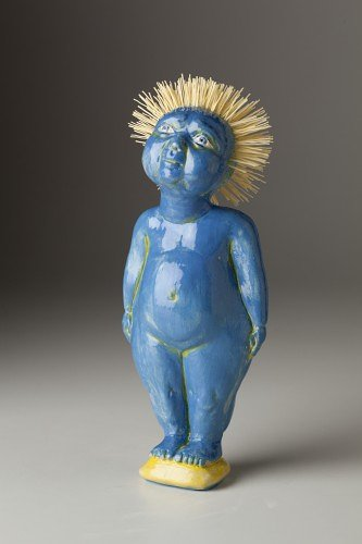 clay sculpture of blue baby with spiky hair