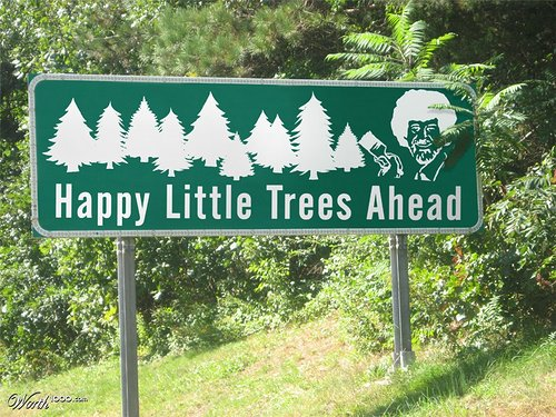 road sign with Bob Ross that says Happy Little Trees Ahead
