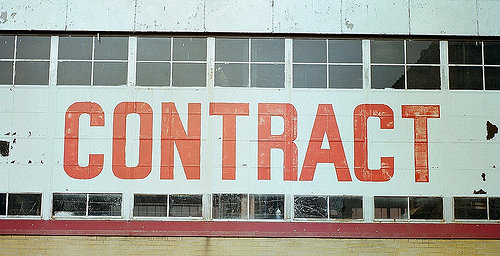 building with the word contract written on it in giant letters