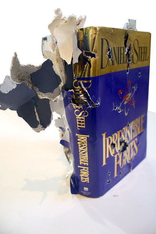 book that has been destroyed by gun shot