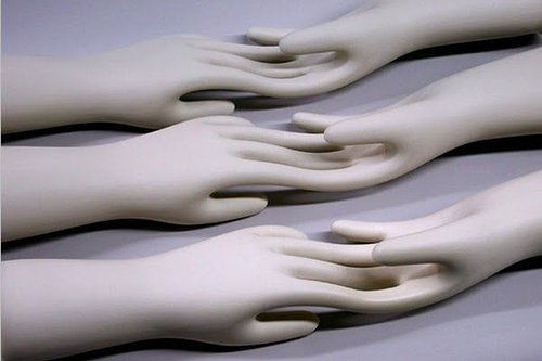 sculpture of mannequin hands where the fingers merger together with opposite hand