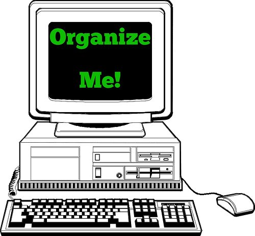 illustration of computer  with the words organize me on the screen