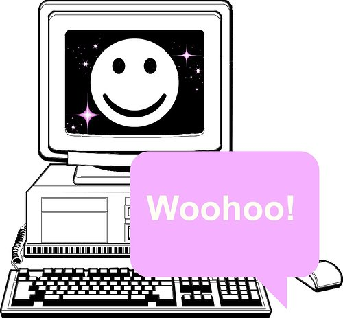 computer with smily face on the screen and text that says woohoo