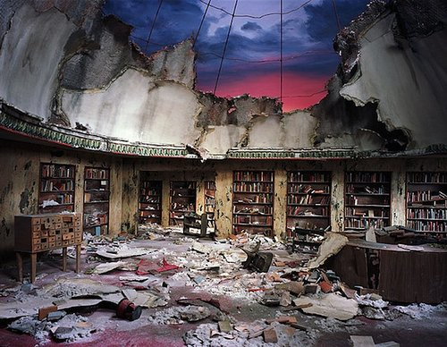 diorama sculpture of library with the roof collapsed