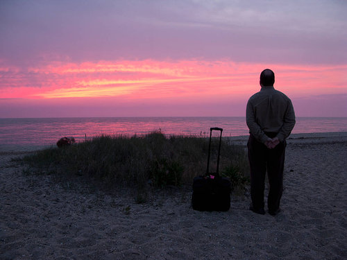 sunset photography with man and suitcase