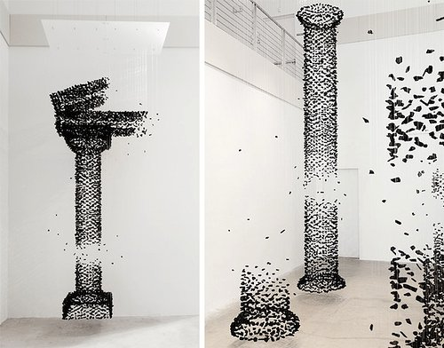 two views of suspended coal sculptures