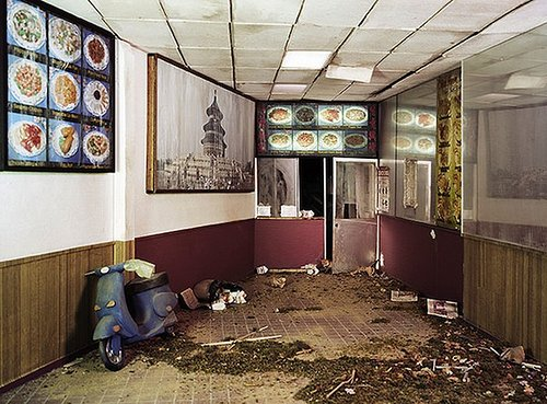room with debris and a scooter