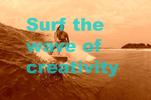 surfer on a wave with text overlay that says surf the wave of creativity