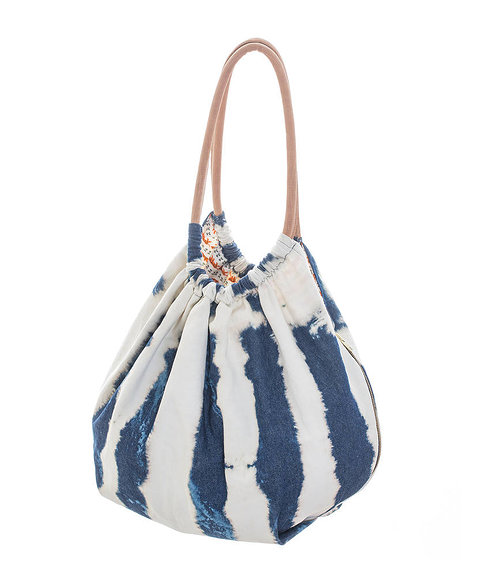 A hand-dyed blue and white handbag