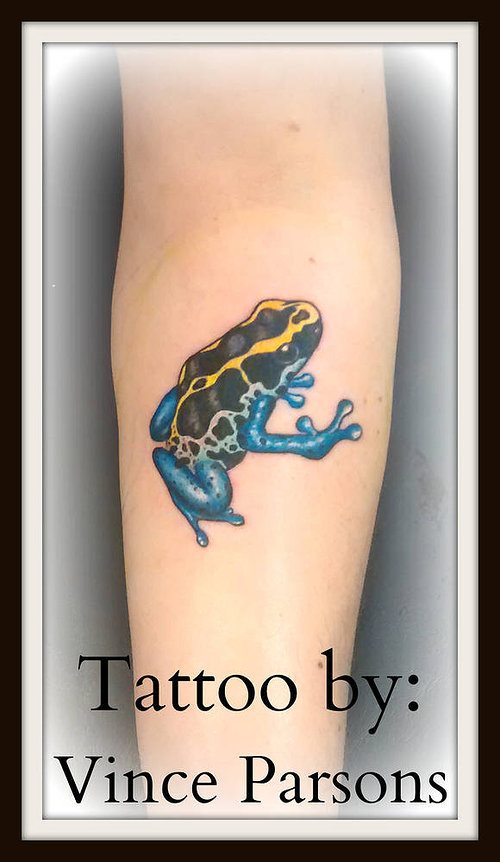 A small tattoo of a poison dart frog