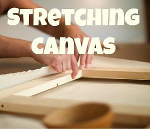 Someone stretching canvas with the words stretching canvas.