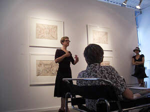 Woman giving an artist's talk