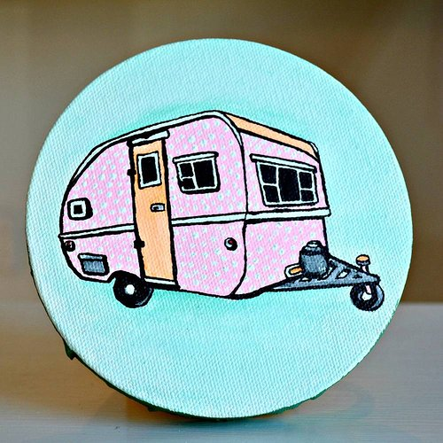 A simplistic painting of a trailer on a small round canvas