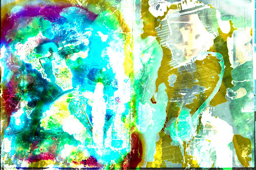 An abstract painting on a film negative with bright, strange colours