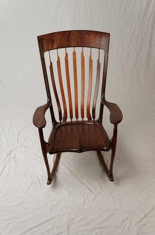 A photo of a handmade walnut rocking chair