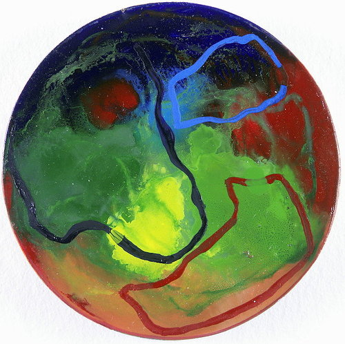 An abstract painting made by pouring layers of thin paint onto a round surface