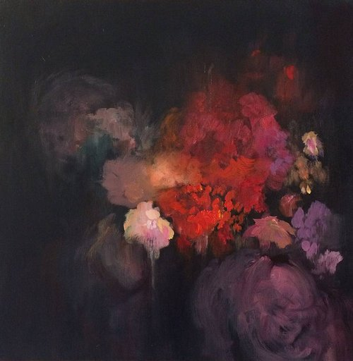 A dark, dramatically lit floral still-life