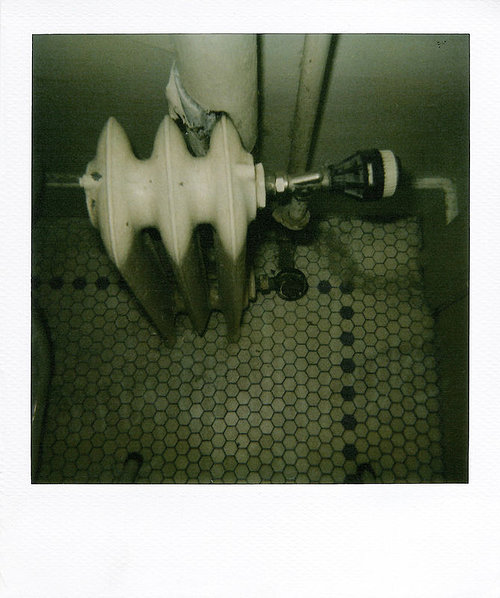 A polaroid photo of a bathroom tiled floor